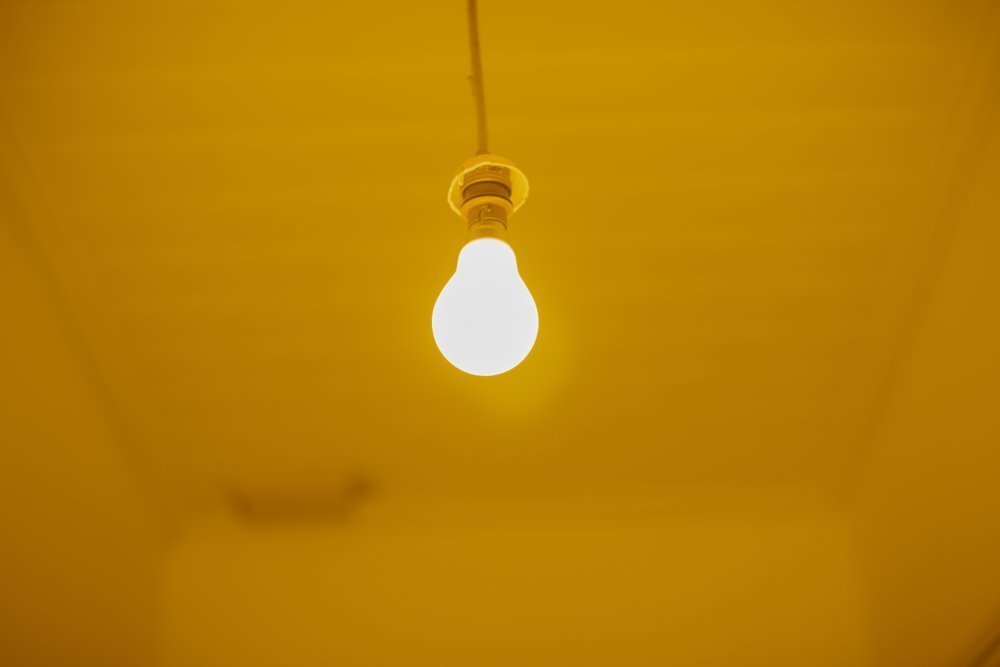 Yellow light is less attractive to bugs.